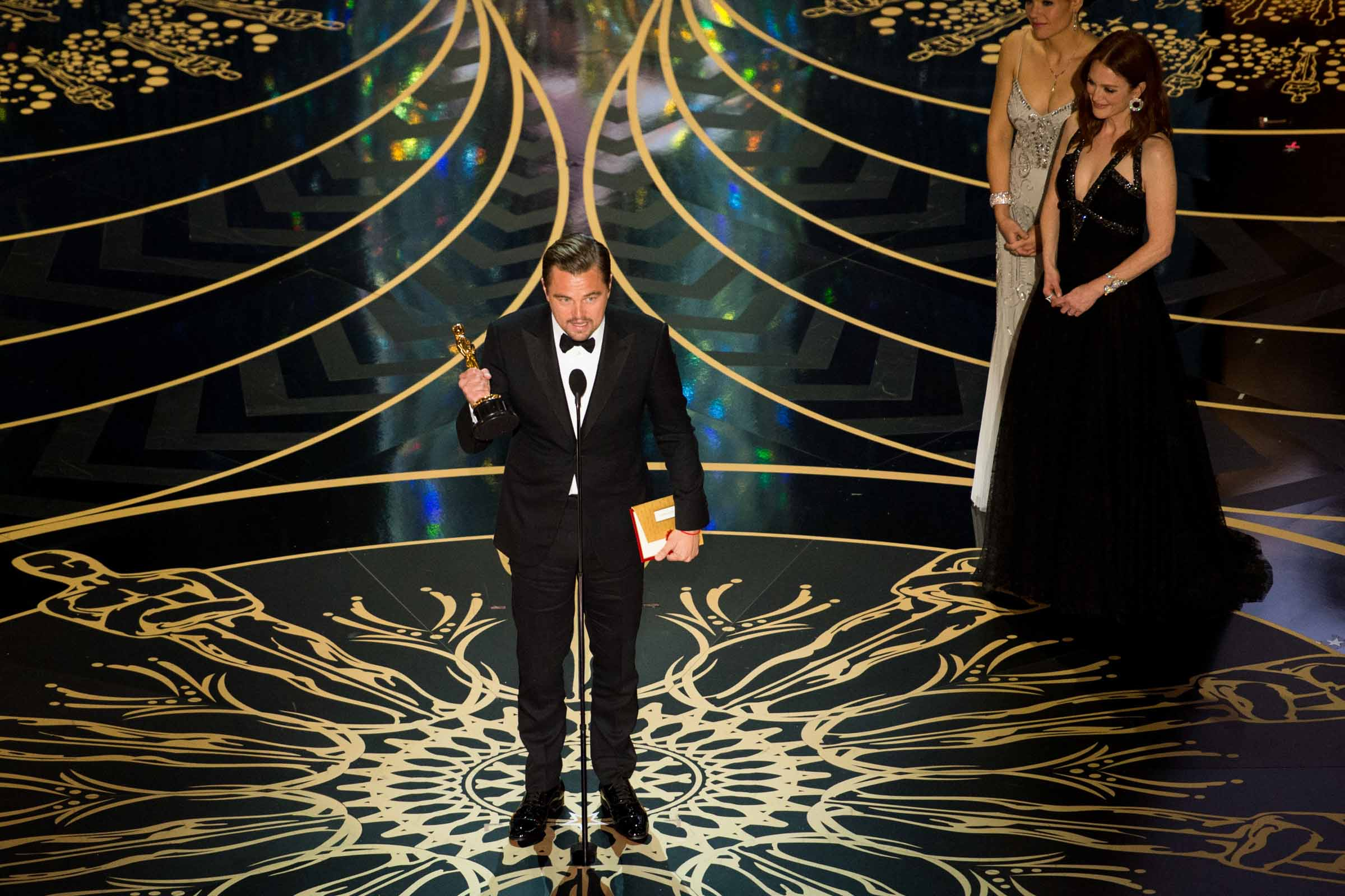 "Leonardo DiCaprio accepts the Oscar® for Performance by an Actor in a Leading Role, for work on ""The Revenant"", from Julianne Moore during the live ABC Telecast of The 88th Oscars® at the Dolby® Theatre in Hollywood, CA on Sunday, February 28, 2016. Photo Credit: Valerie Durant / ©A.M.P.A.S."