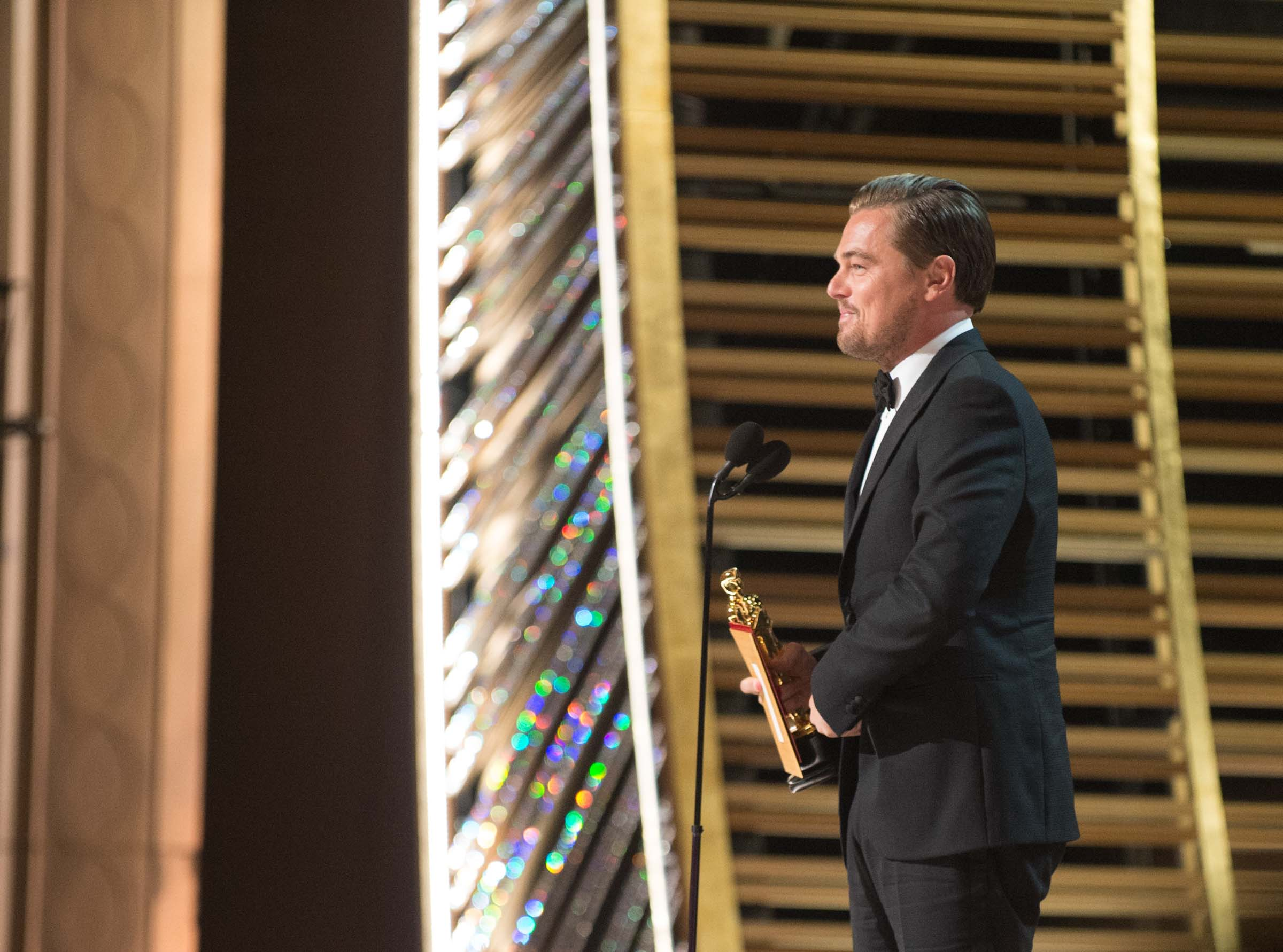 "Leonardo DiCaprio accepts the Oscar® for Performance by an actor in a Leading role, for work on ""The Revenant"" during the live ABC Telecast of The 88th Oscars® at the Dolby® Theatre in Hollywood, CA on Sunday, February 28, 2016. Photo Credit: Todd Wawrychuk / ©A.M.P.A.S."
