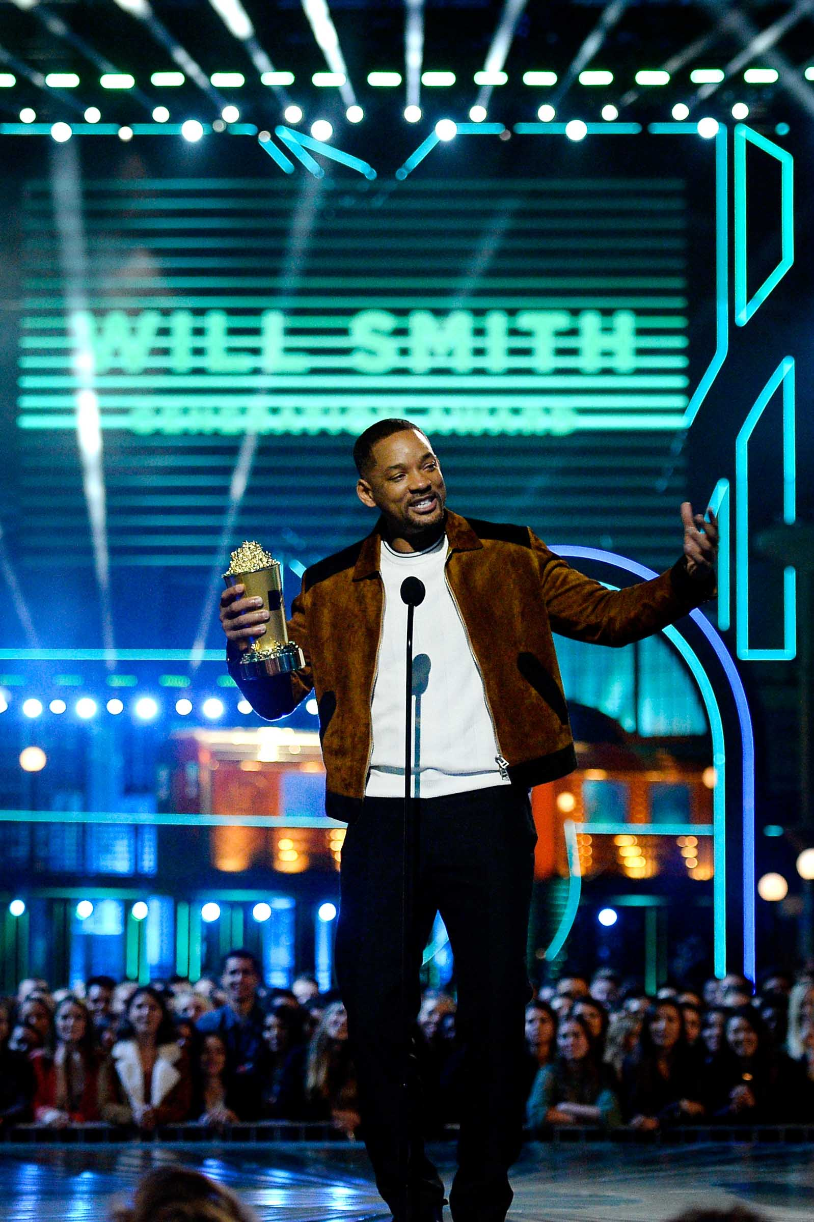 """BURBANK, CALIFORNIA - APRIL 09:  Actor Will Smith accepts the MTV Generation Award onstage during the 2016 MTV Movie Awards at Warner Bros. Studios on April 9, 2016 in Burbank, California.  MTV Movie Awards airs April 10, 2016 at 8pm ET/PT.  (Photo by Kevork Djansezian/Getty Images)"""