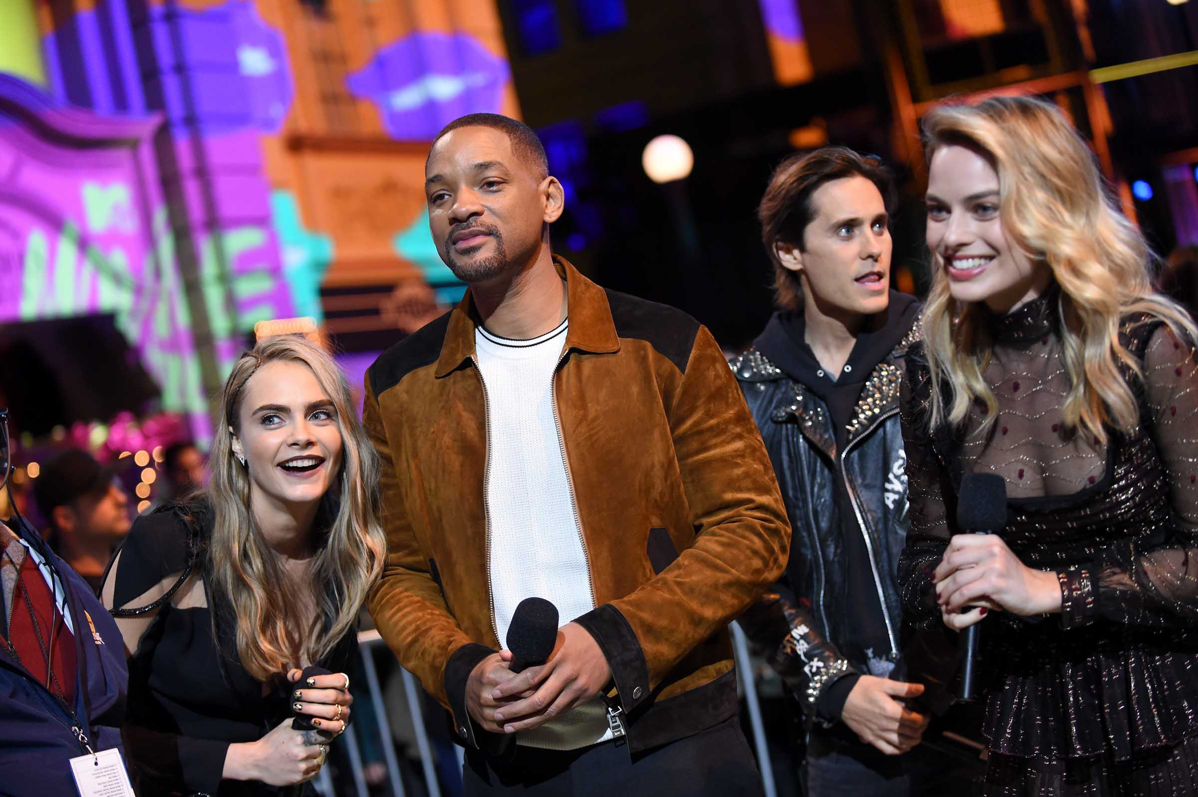 """BURBANK, CALIFORNIA - APRIL 09:  (L-R) Actress Cara Delevigne, Will Smith, Jared Leto and Margot Robbie speak onstage during the 2016 MTV Movie Awards at Warner Bros. Studios on April 9, 2016 in Burbank, California.  MTV Movie Awards airs April 10, 2016 at 8pm ET/PT.  (Photo by Emma McIntyre/Getty Images for MTV)"""