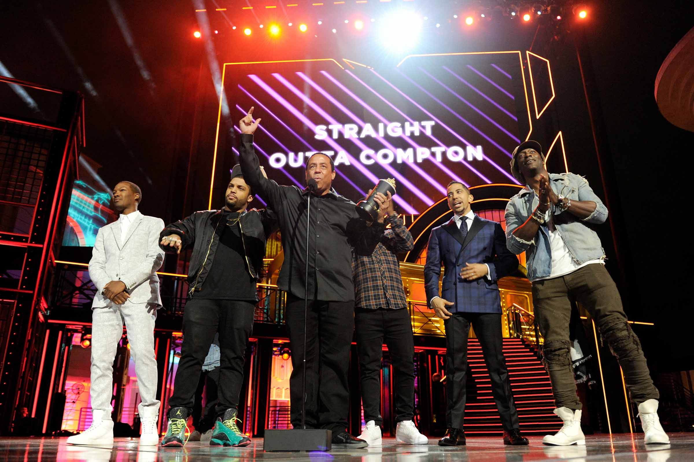"""BURBANK, CALIFORNIA - APRIL 09:  (L-R) Actor Corey Hawkins, actor Jason Mitchell, rapper DJ Yella, actor O'Shea Jackson Jr., actor Neil Brown Jr. and Alda Hodge accept the True Story award for 'Straight Outta Compton' onstage during the 2016 MTV Movie Awards at Warner Bros. Studios on April 9, 2016 in Burbank, California.  MTV Movie Awards airs April 10, 2016 at 8pm ET/PT.  (Photo by Emma McIntyre/Getty Images for MTV)"""
